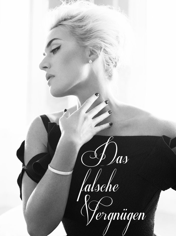 Kate Winslet in a fancy dress brushing her fingers down her own neck.